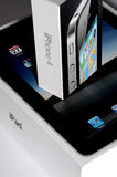 Apple Ipad and Iphone 4 Boxes - Closeup. Apple Ipad and Iphone 4 Boxes on top of each other Royalty Free Stock Images