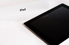 Apple iPad med den återförsäljnings- asken Royaltyfri Foto