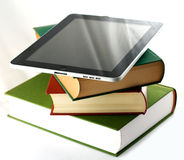 Apple ipad on a stack of books Royalty Free Stock Image