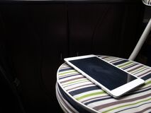 Apple iPad on striped chair
