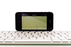 Apple iPhone 4 Wireless Keyboard. Capability Makes For Easier Business Use Stock Photo