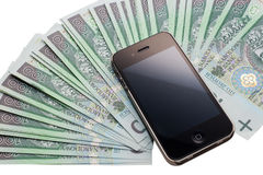 Apple iPhone 4GS and a lot of money. Royalty Free Stock Photos