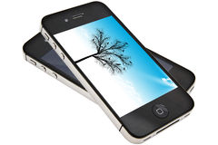 Apple iPhone 4s. Beautiful art tree display on iPhone 4s screen Royalty Free Stock Images