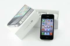 Apple iPhone 4s. In black with packaging, isolated in white background Royalty Free Stock Photos