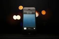 APPLE IPHONE 5 DISPLAYS NEW YEAR. RIYADH, SAUDI ARABIA - December 23, 2012: Apple iPhone 5 displays January 1st at midnight Stock Photography