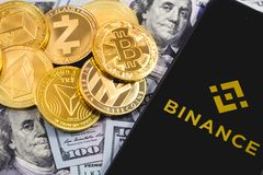 Apple iPhone and Binance logo, and dollars, cryptocurrency. Binance is a cryptocurrency exchange. Ekaterinburg, Russia -. September 19, 2018 royalty free stock images