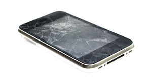 Apple iPhone with a broken screen. A dropped iphone that has a broken screen stock photos