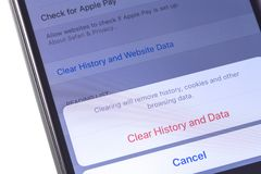 Apple iPhone with browser Safari remove history, cookies and other browsing data. Apple Inc. is an American multinational. Technology company in Cupertino stock photos