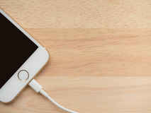 Apple iPhone6 Charging with Lightning USB Cable royalty free stock photos