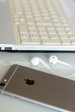 Apple iPhone on desk with wired earphones Stock Photos