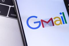Apple iPhone with Gmail logo on the keyboard. Russia - October 0. Apple iPhone with Gmail logo on the keyboard stock image