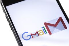 Apple iPhone with Gmail logo on the white background. Russia - O. Apple iPhone with Gmail logo royalty free stock image