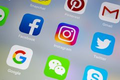 Apple iPhone X with icons of social media facebook, instagram, twitter, snapchat application on screen. Social media icons. Social. Sankt-Petersburg, Russia royalty free stock image