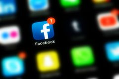 Apple iPhone X with icons of social media facebook stock images
