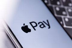 Apple iPhone with Apple Pay logo on the keyboard. Russia - Octob. Apple iPhone with Apple Pay logo on the keyboard stock image