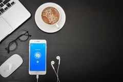 Apple iPhone 8 plus with Shazam app. Kyiv, Ukraine - Fabruary 6, 2018: Apple iPhone 8 plus with Shazam app on the screen with headphones and coffee  on black Stock Photo