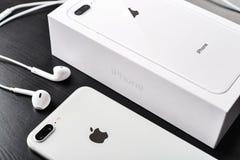 Apple iPhone 8 Plus Silver. Kyiv, Ukraine - January 24, 2018:Unpacked new Apple iPhone 8 Plus Silver  on wooden background. IPhone 8 Plus was created and Stock Photos