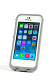 Apple IPhone 5S cell phone in a Lifeproof case Stock Image