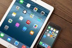 Apple iPhone 5s and iPad Air 2. KIEV, UKRAINE - JANUARY 29, 2015: Apple iPhone 5s, iPad Air 2 on table. Apple Inc. is an American multinational corporation that Royalty Free Stock Photo