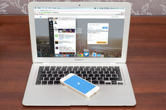 Apple iPhone 5S with Twitter logo on screen. Pavlograd, UKRAINE - December 18 2014: brand new Apple iPhone 5S with Twitter logo on the screen and twitter page on Stock Photos