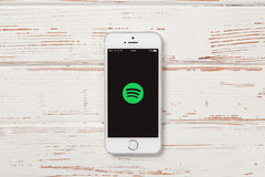Apple iPhone SE. WROCLAW, POLAND - APRIL 12, 2016: Apple iPhone SE smartphone with Spotify app on screen stock photo