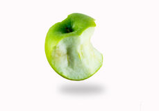 Apple. Isolated half eaten green apple on the white background stock images