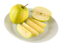 Apple isolated. Apple slices on the plate Stock Photos
