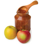 Apple jam. In the pot with a wooden spoon Stock Photos