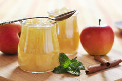 Apple jam with cinnamon. And mint on wooden cutting board stock image
