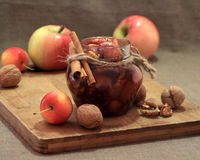 Apple jam with cinnamon sticks. Royalty Free Stock Images