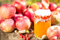 Apple jam and fruits on wooden table Royalty Free Stock Photo