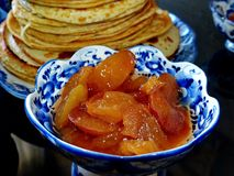 Apple jam for russian blinov in the vase Gzhel.Maslenitsa is an Eastern Slavic traditional holiday.Gzhel. Russian folk craft of ceramics and production royalty free stock photo