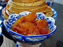 Apple jam for russian blinov in the vase Gzhel.Maslenitsa is an Eastern Slavic traditional holiday.Gzhel. Russian folk craft of ceramics and production stock image