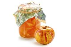 Apple-jampot met appel op wit Stock Foto's