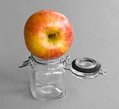 Apple on jar Stock Photo