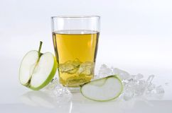 Apple juice. Half green apple and apple juice royalty free stock photography