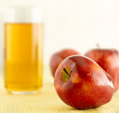 Apple with juice Royalty Free Stock Photos