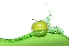 Apple in juice Stock Photos