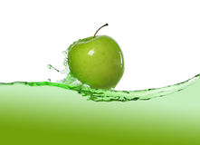 Apple in juice stock image