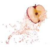 Apple in juice stock photography