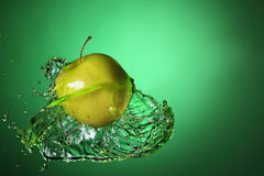 Apple in juice Royalty Free Stock Photo