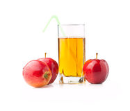 Apple juice. In a glass nearby three apples Royalty Free Stock Image