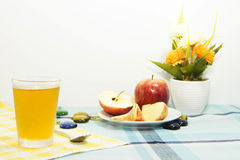 Apple juice with apple sliced on tablemat Stock Photos