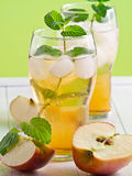 Apple juice with Apple slices Royalty Free Stock Images