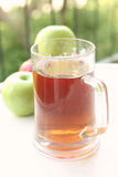 Apple juice and apples Stock Images