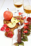 Apple juice, apples and autumn leaves Stock Images