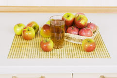 Apple juice with apples on the table. Apple juice in a glass on a table with apples Stock Photography
