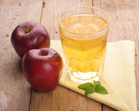 Apple juice. And apples on wooden table. Selective focus Stock Photography