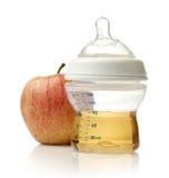 Apple juice in baby bottle Stock Photography