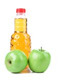 Apple juice in a bottle and ripe apples. Royalty Free Stock Photos